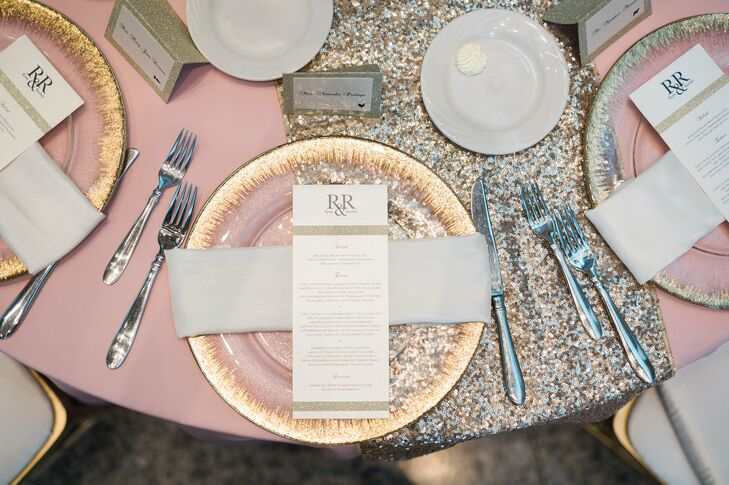 A palette of old silver, white and blush metallic dinnerware adorned the tables.