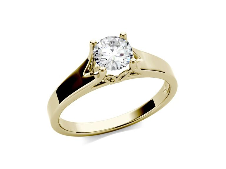 Charles & Colvard round colorless moissanite four prong solitaire engagement ring in 14K yellow gold