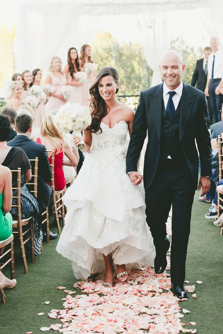 Jocelyne's Pnina Tornai wedding dress was the epitome of modern romance. The lacy, corseted sweetheart bodice offered just the right amount of sexiness, while the asymmetrically layered lace skirt provided plenty of flirty, feminine appeal.