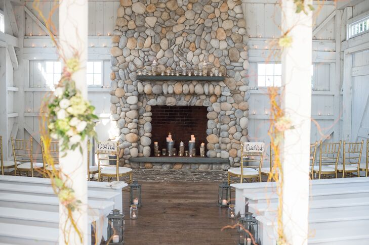 Rather than a traditional altar,  Bonnet Island Estate's chapel had a cobblestone fireplace as its backdrop. Miriam and Mark filled the space with candlelit lanterns and mason jars along the aisle as well as candles in the fireplace itself.