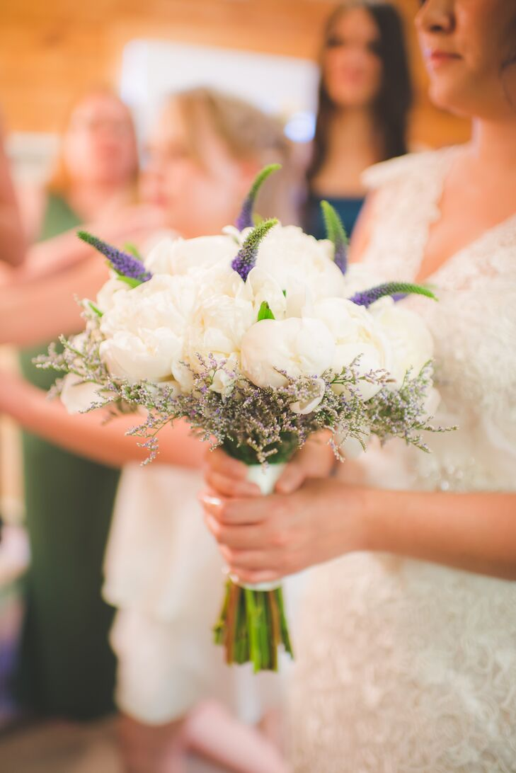 Tessa carried a white peony bouquet accented with lavender, which were created by Secret Window Floral Studio.