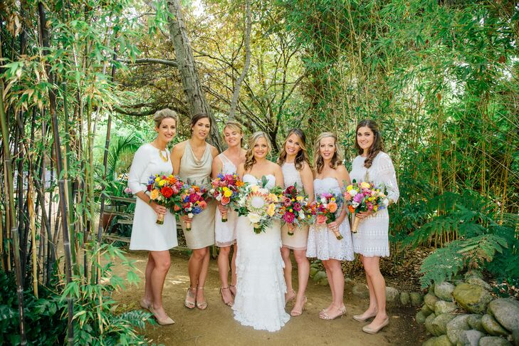 """The bridesmaids wore their own tea-length dresses and shoes in a mix of colors from nude to gold. """"The girls looked amazing,"""" Mallory says. The best part? """"Hopefully, they'll be able to repurpose their dresses."""""""