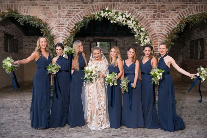 """The style was formal and very classic,"" Olga says of her lace gown and cathedral-length veil and the bridal party attire."