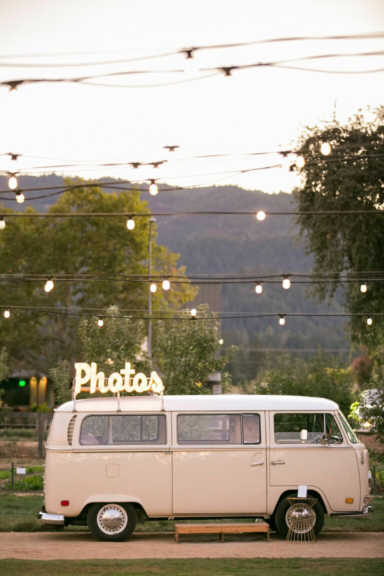 Beige VW bus photo book with marquee lights