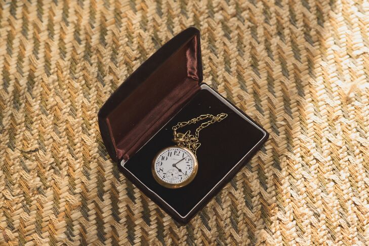 A pocket watch on a gold chain added a vintage touch to the groom's style.
