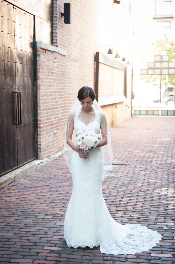 "The bride wore a white lace dress by Marisa with a keyhole back along with a veil that was worn by two of her cousins before her. ""Both of them stood up in the wedding, which made it very special,"" she says."