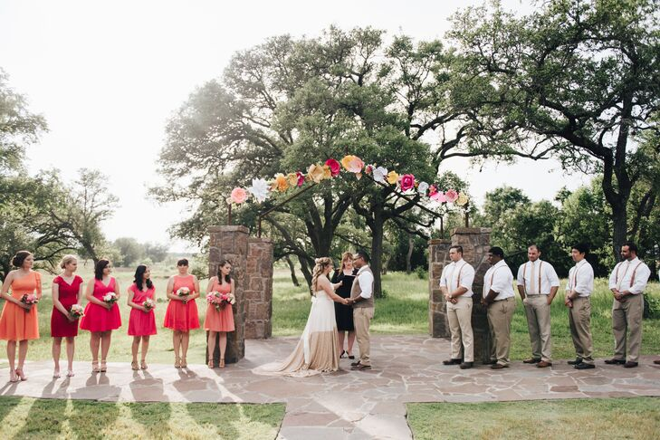 """Our wedding was in the middle of May in Texas so we didn't want anything that would cause our wedding party to pass out from the heat,"" explains Victoria. ""So we went with simple white dress shirts, khaki pants and suspenders."""