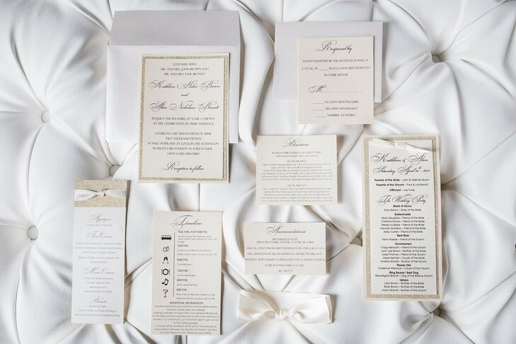 Kathleen and Alan wanted to set the tone for their wedding early with simple, elegant stationery. The invitations were printed on champagne card stock with sparkly gold accents and cursive typography.