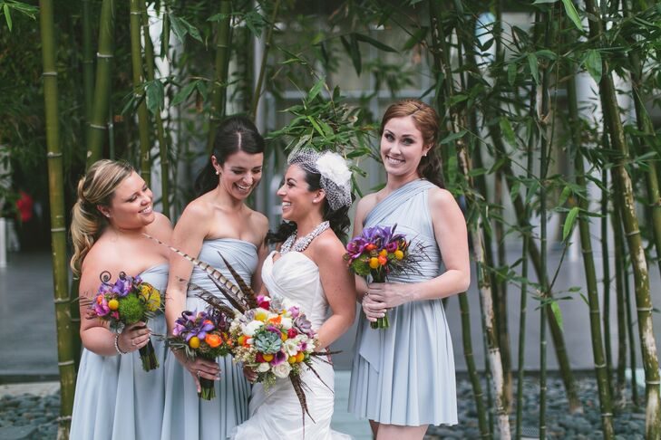 """Each bridesmaid wore the infinity dress by the Radical Thread in a shade of heather gray, picked out by Kaitlyn, who absolutely loved the idea of the gowns. """"Each bridesmaid could virtually wrap it to fit their own style and make them feel their best,"""" Kaitlyn says."""