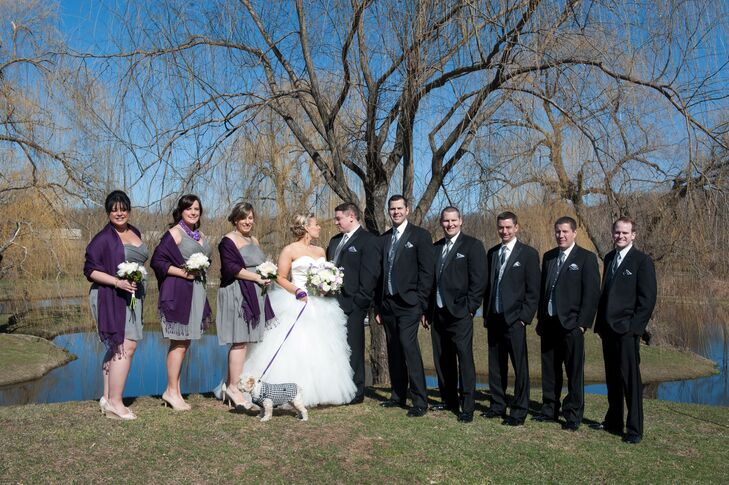 """My groom and his groomsmen all wore subtle pin striped tuxedos with silver and gray ties and a vest and periwinkle-hued pocket squares,"" Lisa says. ""They all had on fun argyle black, gray and purple socks too."""