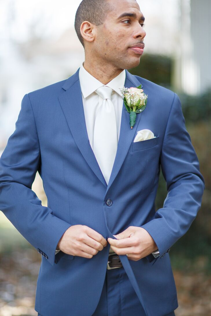 6a556fa0b Groom in a Blue Suit, White Tie and Rose Boutonniere