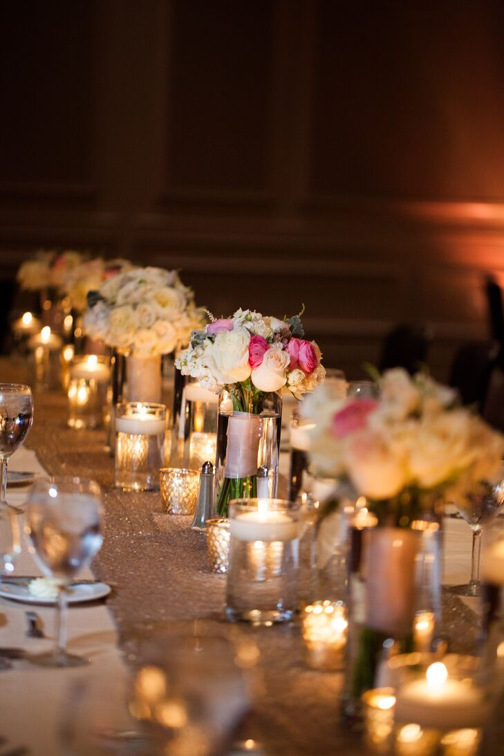 Some of the bridesmaids' bouquets sat between groups of floating candles spanning the length of the estate table.