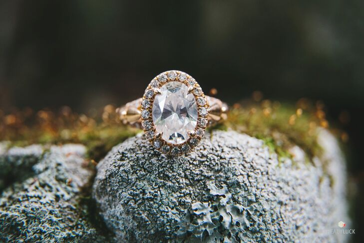 """A local jeweler created custom rings for the couple. """"I had seen so many engagement rings, and I knew I wanted something different,"""" Amy says. Geoff had an oval diamond with split shank sides and a mix of rose and yellow gold created for Amy. """"He did a wonderful job,"""" Amy says."""