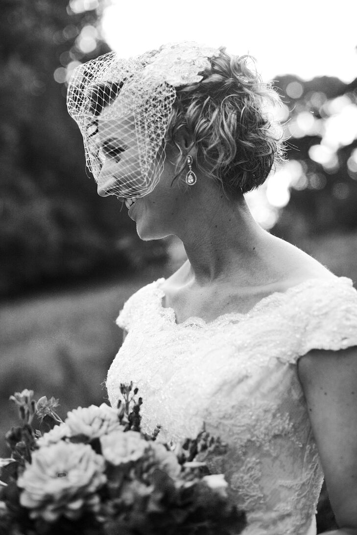 Kate accessorized with a fascinator veil on her wedding day. Her hair was styled by Jewel Hair Design. She also wore pearl drop earrings.