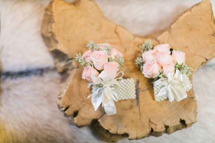 Small bunches of pastel pink roses were tied with a white satin ribbon for the romantic boutonnieres.