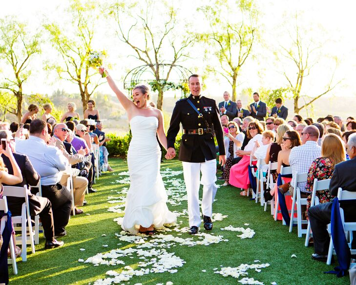 Bride Cheers with Joy as She Recesses Down the Aisle with her Husband