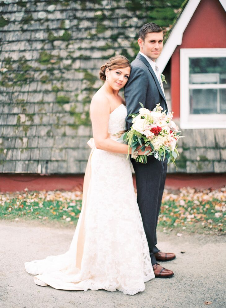 Lauren looked beautiful in a champagne Maggie Sottero wedding dress with an ivory lace overlay. The dress featured a champagne ribbon sash. Stephen complemented her in a gray suit.