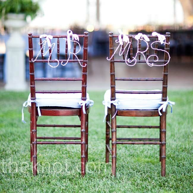 "Beaded letters spelling out ""Mr."" and ""Mrs."" hung from the backs of Beth's and Dave's chairs at dinner."
