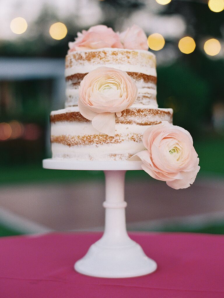 Mini nearly naked wedding cake with pink ranunculus