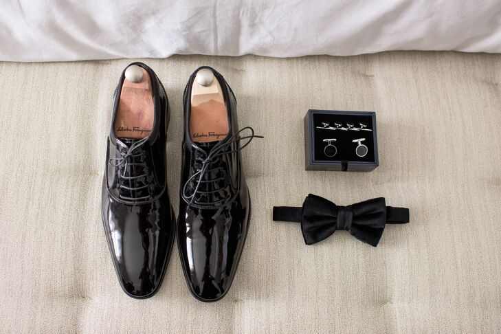 Going for a classic look, Eric donned a bespoke black tuxedo with a velvet bow tie, monogrammed pocket square, patent leather oxford shoes and deep purple socks to match the groomsmen and bridesmaids.