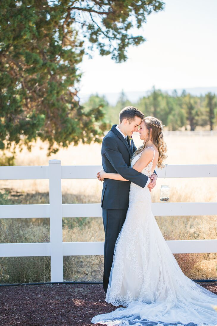 """Abigail wore a Martina Liana fit-and-flare dress with ivory lace. """"The straps were delicate, intricately beaded lace that opened to a low back. It was elegant, but the amount of lace and detailed beadwork covering the dress made a rather western, eclectic wedding theme feasible to work around,"""" Abigail says."""