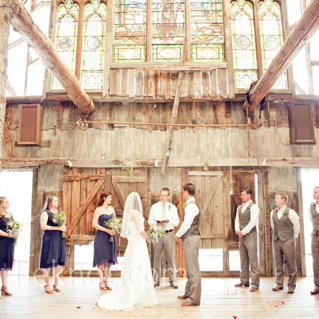 After reading each other's private vows, Holly and Matt exchanged traditional vows under the large stained-glass window inside the barn.