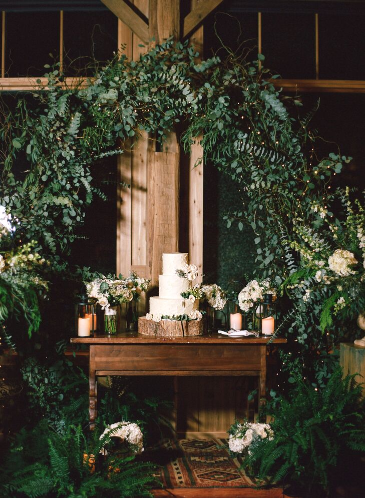 "It was important to Charlotte and Jeff that their wedding be elegant and romantic but with a rustic mountain charm. ""With that in mind, we were drawn to a natural aesthetic with wood, neutral tones and silver highlights,"" Charlotte says. The decor in the barn was kept simple, but hanging linens and candles were added for softness."