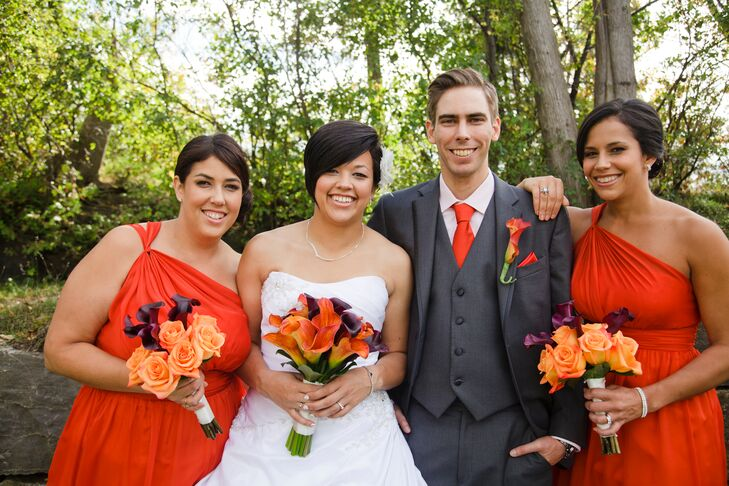 Stephanie M. had her bridal party wear her favorite color:  orange dresses and accents.