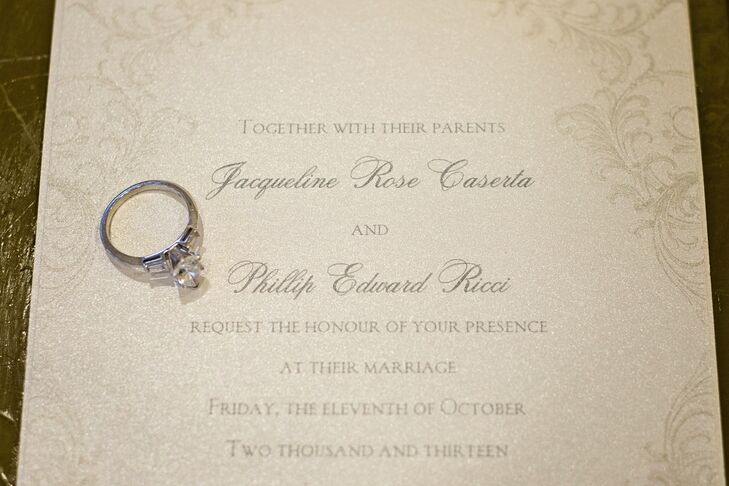 The couple had pearl-colored invitations with grey thermography type from The Papery.