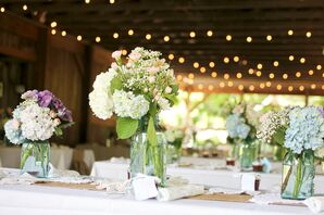 Reception in a Barn with Picnic Table Seating and String Lights