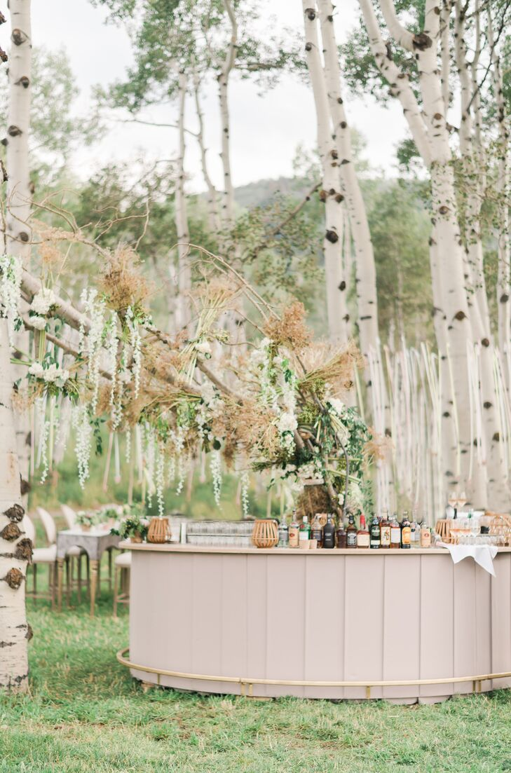 Custom Wood Bar with Dramatic Branch Arrangement