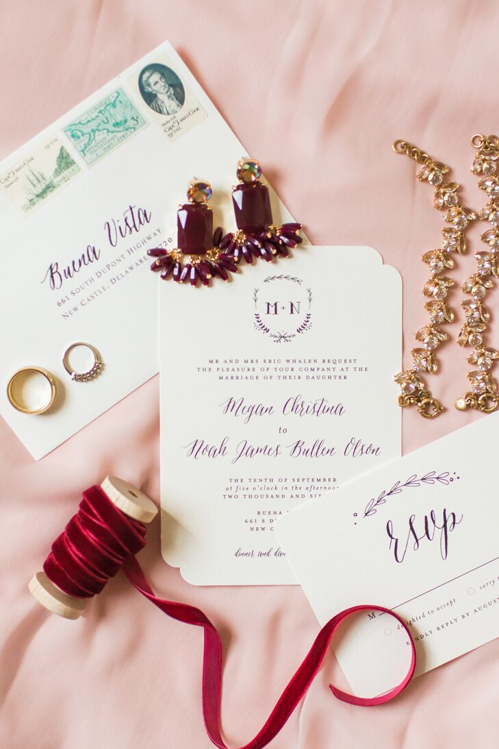 """We splurged on invitations we found on Minted.com and then found a vendor on Etsy.com that sold PDFs similar to the font style of our invitations,"" Megan says. ""We were able to create our programs, seating chart boards, menu cards and tags for our hotel welcome bags for a really affordable price."" The ivory card stock invitations featured a decorated border, a whimsical font and olive-leaf-inspired flourishes for a playfully rustic look."