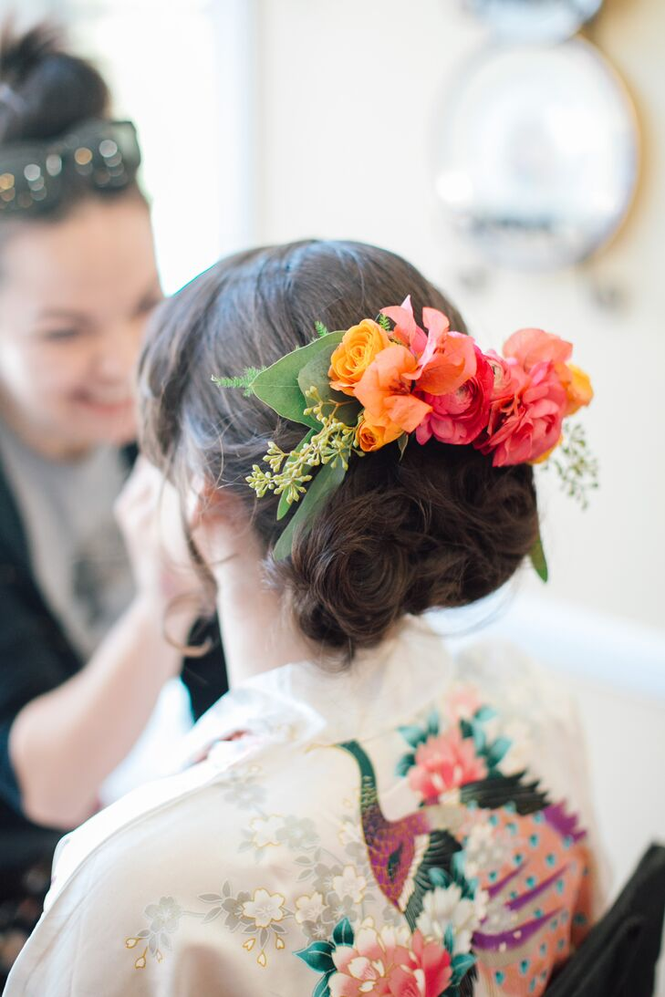 Romantic Curled Updo with a Vibrant Rose Hair Accessory