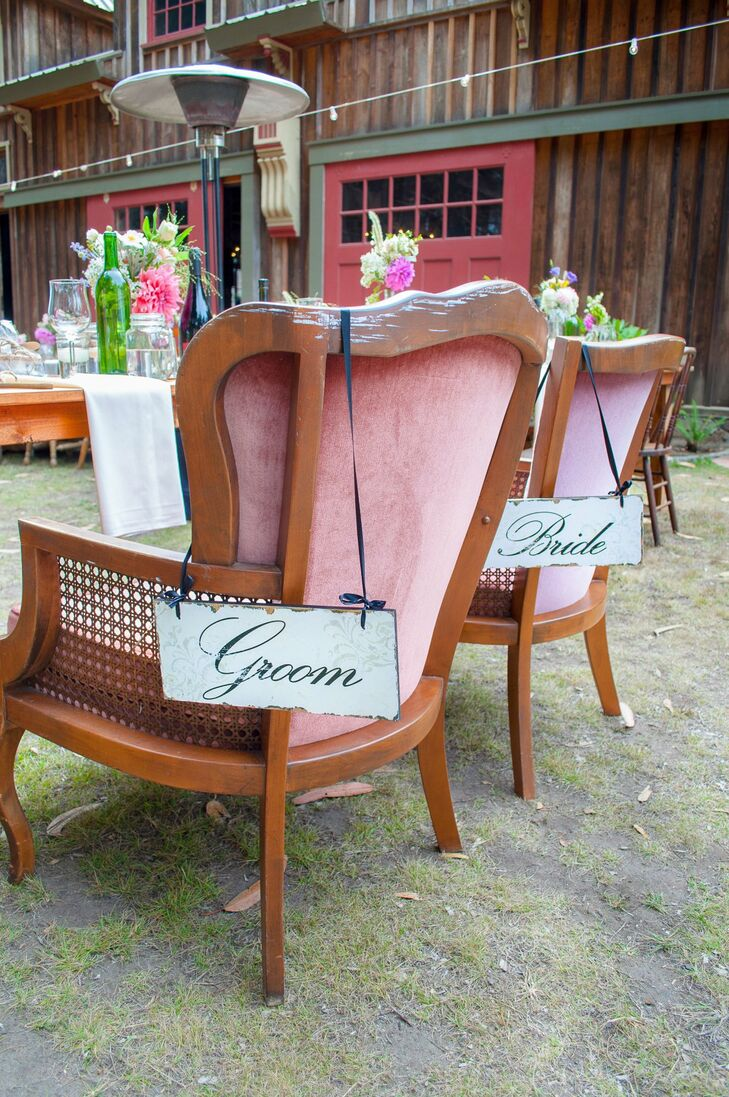 Vintage upholstered club chairs were placed at the table for the bride and groom.