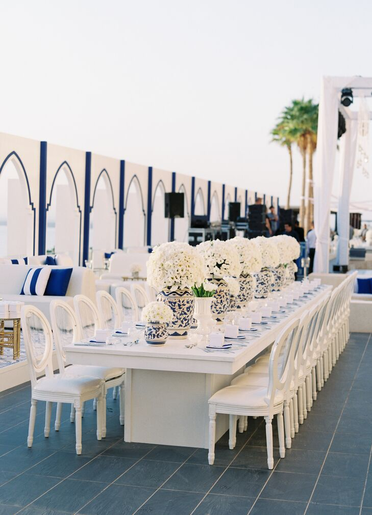 With breathtaking views of the sun setting over the Dead Sea, the couple opted for understated yet elegant decor. Adorned with blue-and-white-patterned vases of varying sizes overflowing with fresh white blooms specially ordered from the Netherlands, textured dinnerware and lots of candlelight, the whitewashed wooden tables exuded a modern, romantic vibe.