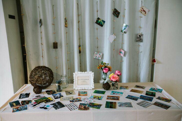 Vintage-inspired postcards were scattered across the guestbook table. Guests could write a note to the couple and pin their well wishes to a twine garland with a mini clothes pins.