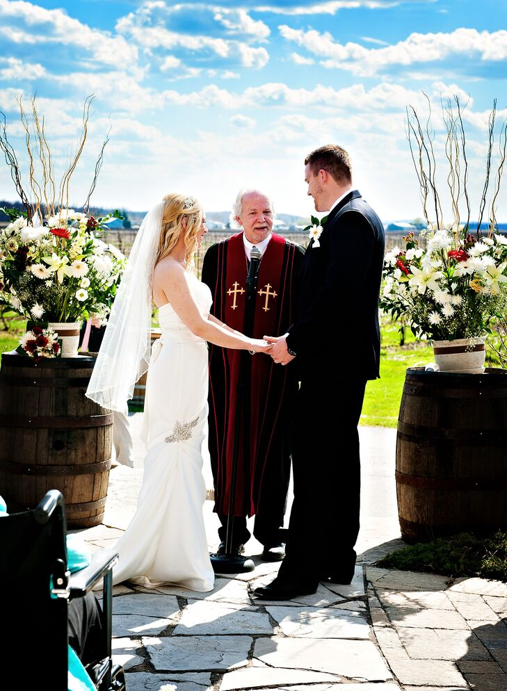 The couple exchanged vows outdoors overlooking the gorgeous vineyard at Holland Marsh Wineries.