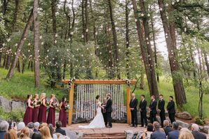 Romantic Outdoor Ceremony with String Lights, Wooden Wedding Arch and Paper Crane Backdrop