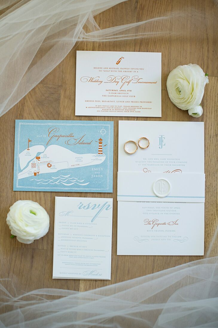 """Emily and Jason's invitations gave guests a preview of the waterfront affair with bright orange script and a custom watercolor map. """"One of our friends designed a logo for us with our initials,"""" Emily says. """"We had the logo printed on a wax seal on our invitation, and we used it in different colors throughout the weekend."""""""