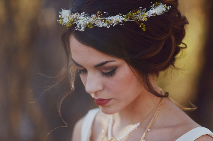 While Madelyn's dress read modern romance, the subtler details helped her achieve the bohemian flair she was after. Madelyn opted for a loose, romantic updo for her walk down the aisle, which she adorned with a delicate flower crown. For her makeup she wore a smoky eye and dramatic red lipstick for a look that was both glamorous and timeless.