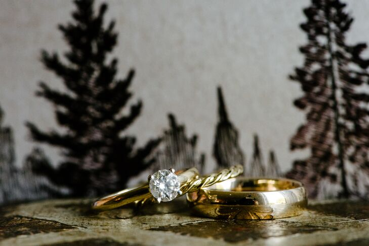 During the ceremony, Meredith and Justin exchanged classic gold wedding bands. Justin's was a traditional, polished yellow gold band, while Meredith's was a dainty twisted style, also in yellow gold.