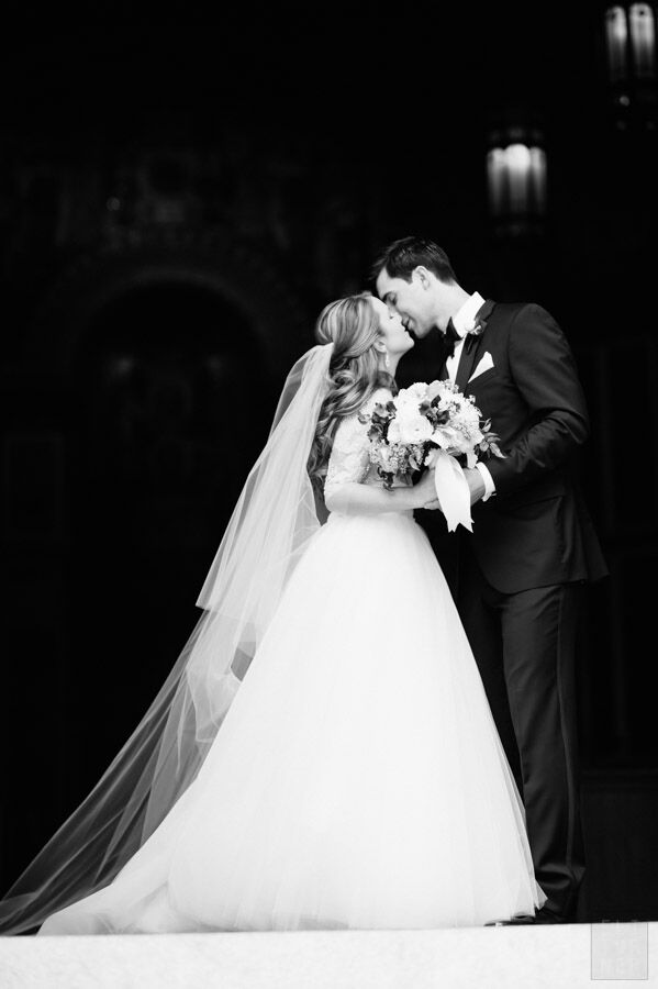 Bride in a Cathedral Veil with Her New Husband