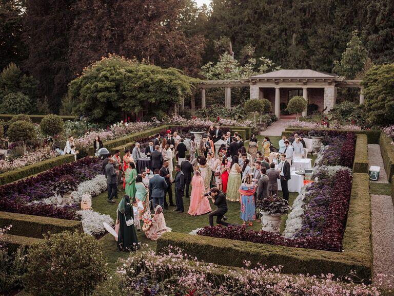 Guests mingling at outdoor black-tie wedding in garden
