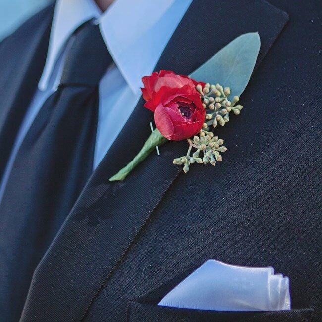 Josh accessorised his suit with a simple red ranunculus boutonniere.