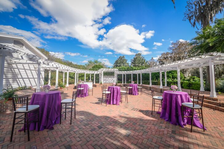 Cocktail Tables with Purple Linens and Centerpieces