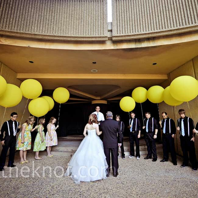 The couple said their vows in the Civic Center's Rock Garden, with attendants holding oversize balloons for a modern look.