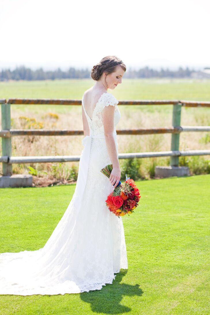 Sara picked the first dress she tried on at Danelle's Bridal— a white-sleeve dress with a front and back V-neck, embroidered in lace from the bodice to the overlay.