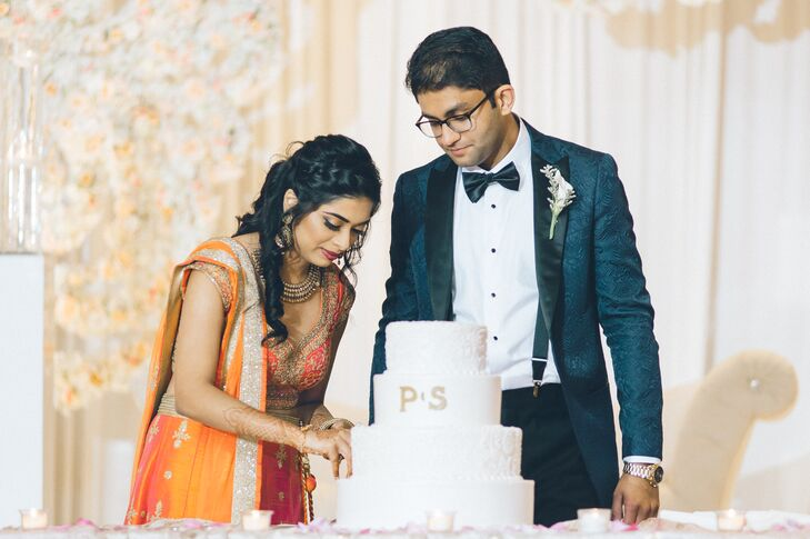 Couple Cutting Round Tiered Cake at Reception