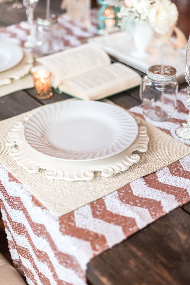 The sweetheart table place settings had a vintage plate and charger atop a glittery copper chevron runner.