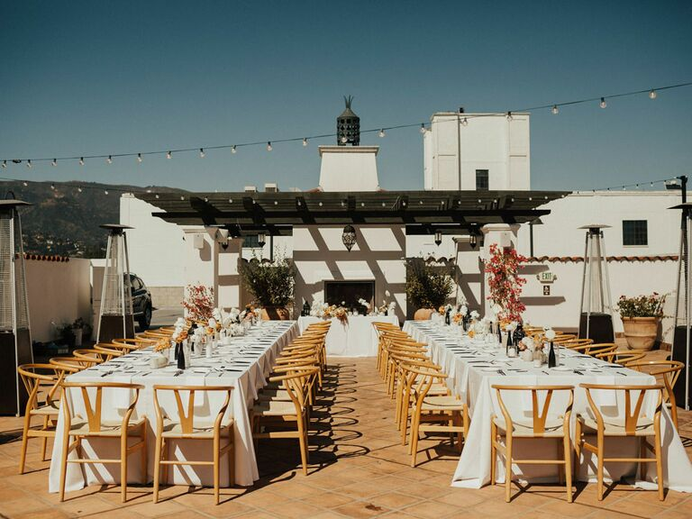 Summer rooftop wedding venue with string lights